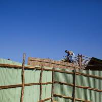 A man works to build a new room at the Thankhali refugee camp in Teknaf, Bangladesh, Sunday. More than 600,000 members of the Muslim minority have fled to Bangladesh since August, when Rohingya insurgents attacked Myanmar police and paramilitary posts, and security forces responded with a scorched-earth campaign against Rohingya villages. | AP