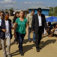 European Union foreign policy chief Federica Mogherini (center) visits the Kutupalong Rohingya refugee camp in Cox's Bazar, Bangladesh, Sunday. More than 600,000 Rohingya Muslims have fled Rakhine for neighboring Bangladesh since late August, when the military launched what it called 'clearance operations' in response to insurgent attacks. | AP