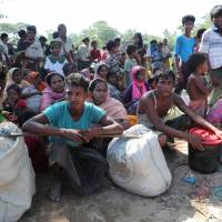 Rohingya refugees who crossed the border are temporarily detained by Border Guard Bangladesh (BGB) in Cox's Bazar, Bangladesh, Sunday. | REUTERS