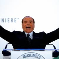 Forza Italia party leader Silvio Berlusconi speaks during a rally in Catania, Italy, on Nov. 2. | REUTERS