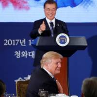 South Korean President Moon Jae-in congratulates U.S. President Donald Trump on the anniversary of his election victory during a state dinner at the presidential Blue House in Seoul on Tuesday. | REUTERS