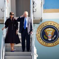 U.S. President Donald Trump and first lady Melania Trump board Air Force One as they depart for Seoul, at U.S. Air Force's Yokota Air Base in Fussa, on the outskirts of Tokyo, on Tuesday. | REUTERS