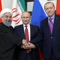 Putin wins backing of Iranian and Turkish leaders for new Syrian peace push