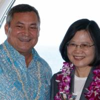 Guam Gov. Eddie Calvo poses with visiting Taiwan President Tsai lng-wen at the Latte of Freedom in Hagatna, Guam, on Friday. | REUTERS