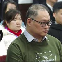 This screen shot from footage on the website of the Yueyang Intermediate People's Court taken on Tuesday shows Taiwanese activist Lee Ming-che appearing in court in Yueyang in China's central Hunan province. | AFP-JIJI