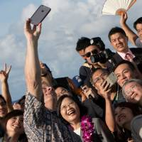 Guam Lt. Gov. Ray Tenorio takes a selfie with visiting Taiwan President Tsai Ing-wen and an accompanying Taiwanese delegation in Hagatna on Friday. | REUTERS