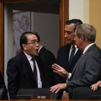 Thae Yong Ho talks with Reps. Joe Wilson (right) and Darrell Issa (second from right) and House Foreign Affairs Committee Chairman Ed Royce before testifying on Capitol Hill on Wednesday. | AFP-JIJI