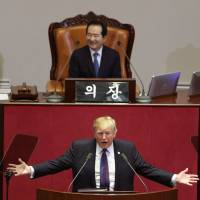 U.S. President Donald Trump delivers a speech as South Korea's National Assembly Speaker Chung Sye-kyun listens at the assembly in Seoul on Wednesday.   AP