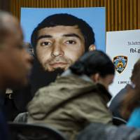 A photo of Sayfullo Saipov is displayed at a news conference at One Police Plaza on Wednesday. | AP