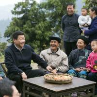 China widens personality cult around its 'servant of the people,' President Xi Jinping