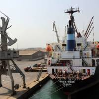 A cargo ship is moored at Yemen's rebel-held Red Sea port of Hodeida Nov. 7. The Saudi-led coalition fighting in Yemen said Wednesday it would reopen the key Red Sea port to receive 'urgent humanitarian. and relief materials' along with Sanaa airport for U.N aircraft from midday (0900 GMT) the next day, after a more than a two-week blockade following a missile attack on the Saudi capital Riyadh. | AFP-JIJI