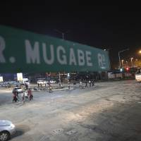 Robert Mugabe road in Harare is seen Tuesday. The Associated Press saw three armored personnel carriers with several soldiers in a convoy on a road heading toward an army barracks just outside the capital, Harare. | AP
