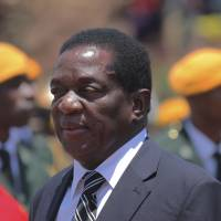 Fired Vice President Emmerson Mnangagwa, shown at the Heroes Acre in Harare on Nov. 1, will become Zimbabwe's interim leader, according to reports. | AP