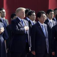 U.S. President Donald Trump, first lady Melania Trump, Prime Minister Shinzo Abe and his wife, Akie, attend a welcome ceremony at the State Guest House in Tokyo's Akasaka district on Monday. | AFP-JIJI