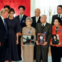 U.S. President Donald Trump and first lady Melania Trump meet former abductees and their families in Tokyo on Nov. 6 to discuss the past kidnappings of Japanese by North Korean spies. | REUTERS
