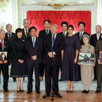U.S. President Donald Trump meets on Monday with former abductees and the families of those kidnapped by North Korea, at the Government Guesthouse in Tokyo, accompanied by first lady Melania, Prime Minister Shinzo Abe and his wife, Akie.   REUTERS