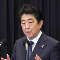 Prime Minister Shinzo Abe speaks at a news conference Tuesday in Manila. | KYODO