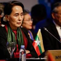 Myanmar's State Councellor and Foreign Minister Aung San Suu Kyi looks on during the ASEAN Canada 40th Anniversary Commemorative Summit on the sidelines of the 31st Association of Southeast Asian Nations (ASEAN) Summit in Manila on Tuesday. | AFP-JIJI