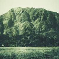 An image of Mount Buko taken by photographer Buko Shimizu in the 1950s shows the mountain before its slopes were scarred from extensive mining. | BUKO SHIMIZU