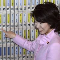 Mayuko Toyota, who was nicknamed 'pink monster' because of her dress sense and reputation as being difficult to work with, celebrates her first successful election campaign in 2012.  | KYODO
