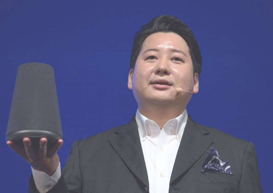 Jun Masuda, chief strategy and marketing officer at Line Corp., gives a presentation on the Clova Wave smart speaker at the company