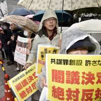 Protesters stage a rally in front of the prime minister's office in Tokyo in March as Prime Minister Shinzo Abe's Cabinet approved an anti-conspiracy bill. | KYODO