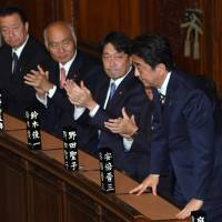 Prime Minister Shinzo Abe receives applause at the Lower House on Wednesday as he is re-elected following the ruling bloc's landslide victory in last month's general election. | SATOKO KAWASAKI