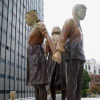 A statue of young girls, erected as a memorial to so-called comfort women, is seen Wednesday in San Francisco. | KYODO