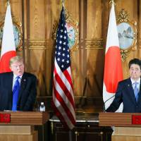 U.S. President Donald Trump and Prime Minister Shinzo Abe give a news conference on Monday at the State Guest House in Tokyo. KYODO