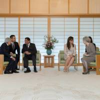 Emperor Akihito (left) talks with Philippine President Rodrigo Duterte (third from left) as Duterte's partner, Cielito Avancena (second from right), talks with Empress Michiko at the Imperial Palace in Tokyo on Tuesday. | REUTERS