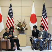 Prime Minister Shinzo Abe talks with Adm. Harry Harris (left), commander of U.S. Pacific Command, during a meeting at Abe's official residence in Tokyo on Thursday. | AP