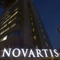 The building that houses the Novartis Pharma K.K. offices stands in Minato Ward, Tokyo. A cardiologist who has followed the data manipulation scandal involving the firm's hypertension drug Diovan recently won a journalism prize for his work. | KYODO