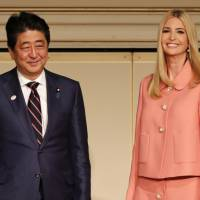 Prime Minister Shinzo Abe and Ivanka Trump attend a meeting of the World Assembly for Women in Tokyo on Friday. | AFP-JIJI
