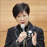 Tokyo Gov. Yuriko Koike announces her resignation as party leader at a meeting of Kibo no To members from both chambers of the Diet on Tuesday. | KYODO