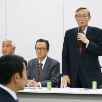 Hiroyuki Hosoda, head of the Liberal Democratic Party's panel promoting constitutional revision, speaks during a meeting at LDP headquarters in Tokyo on Thursday. | KYODO