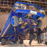 A customized car is entered in a hopping tournament, to see which vehicle can bounce highest on the powerful hydraulics packed into the rear, at the Lowrider Super Show held in Makuhari Messe in Chiba Prefecture earlier this month.   YOSHIAKI MIURA
