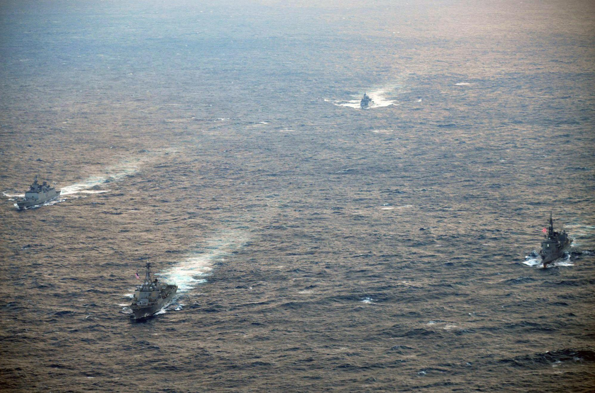 The Maritime Self-Defense Force destroyer Inazuma (right)) participates in a trilateral military exercise with the United States and India in the Sea of Japan on Saturday. | MSDF / VIA KYODO