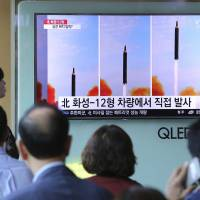 People in a Seoul railway station watch a news report Sept. 16 about a North Korean missile launch.   AP