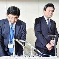 Minoru Nakamura, senior executive director of the Nuclear Waste Management Organization of Japan, bows at a news conference Tuesday in Tokyo, as the organization admitted that students were offered rewards for attending government events related to nuclear waste disposal sites. | KYODO