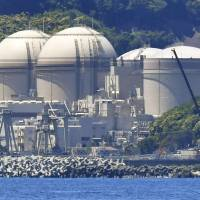 Fukui Gov. Issei Nishikawa's approval of restarting two reactors at the Oi nuclear power plant in the prefecture shows the local economy's dependence on nuclear power. | KYODO