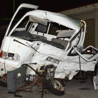 A minitruck that was involved in a collision with a U.S. military truck early Sunday is shown seen at Naha Police Station in Okinawa Prefecture later in the day. | KYODO