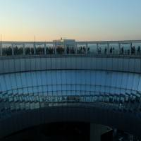People look out at the view from the Umeda Sky Building observation deck in Osaka last month.   BLOOMBERG