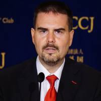 Glen Wood, an equity sales manager at Mitsubishi UFJ Morgan Stanley Securities Co., speaks about the issues he has faced, at the Foreign Correspondents' Club of Japan in Tokyo on Thursday. | MAGDALENA OSUMI
