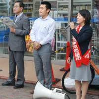 Tokyo assembly member Ryoko Fujita delivers a speech in front of a train station in Ota Ward on Sept. 20. | KYODO