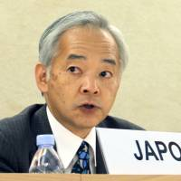 Yoshifumi Okamura, deputy permanent representative of Japan to the United Nations, speaks Tuesday in Geneva at a Human Rights Council meeting on the human rights situation in Japan. | KYODO