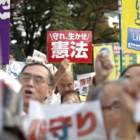 Tens of thousands rally in Tokyo against Abe's push to rewrite Article 9
