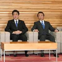 Prime Minister Shinzo Abe and his Cabinet ministers attend a meeting Tuesday at the Prime Minister's Office. | KYODO