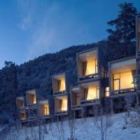 The windows of the Hoshinoya Fuji hotel in Yamanashi Prefecture look out onto Mount Fuji | HOSHINO RESORTS