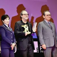 Turkish director Semih Kaplanoglu (third from left), winner of the Grand Prize at the Tokyo International Film Festival, poses with Tokyo Gov. Yuriko Koike and Tommy Lee Jones, who is the head of the Competition jury, in Roppongi on Friday. | YOSHIAKI MIURA