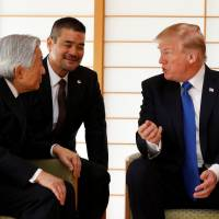 U.S. President Donald Trump talks with Emperor Akihito during their meeting at the Imperial Palace in Tokyo on Monday. | REUTERS